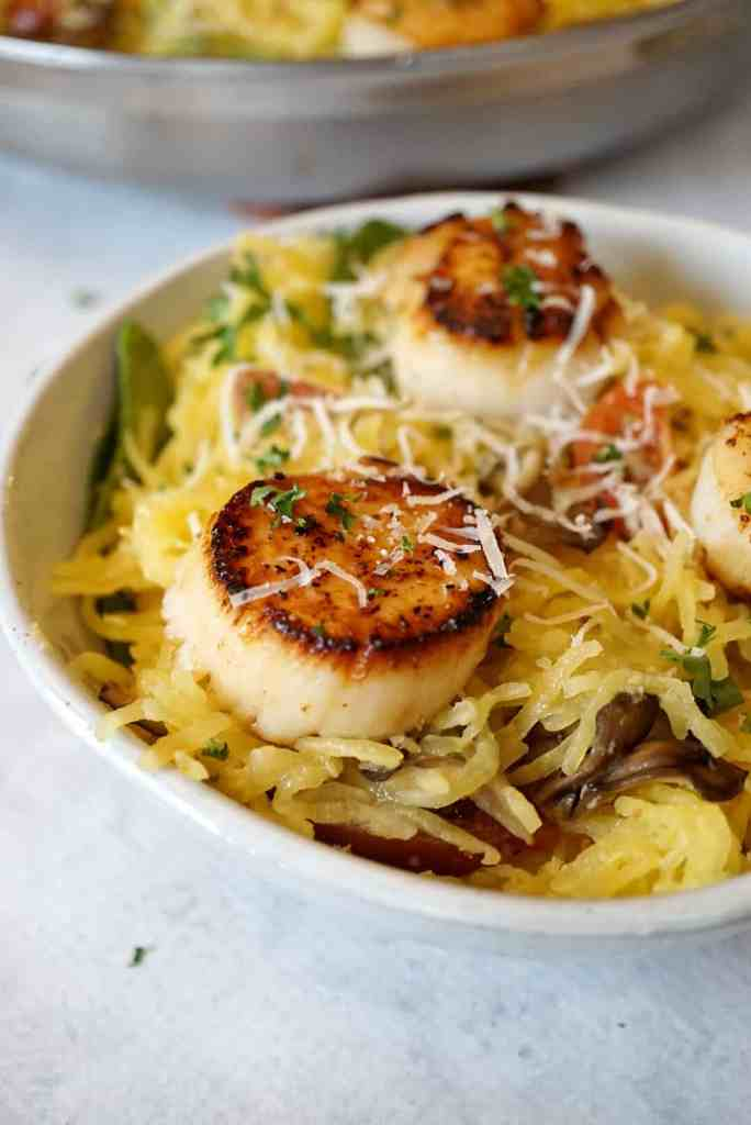 Close up of seared scallops and spaghetti squash