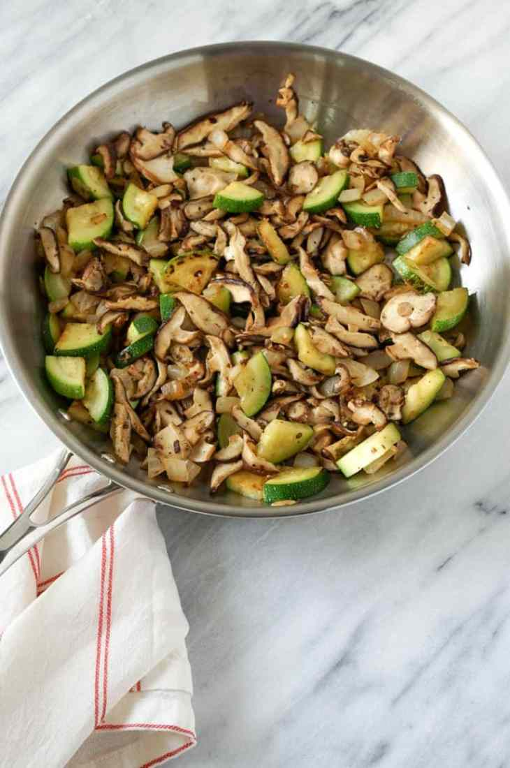 zucchini and mushrooms in a skiillet