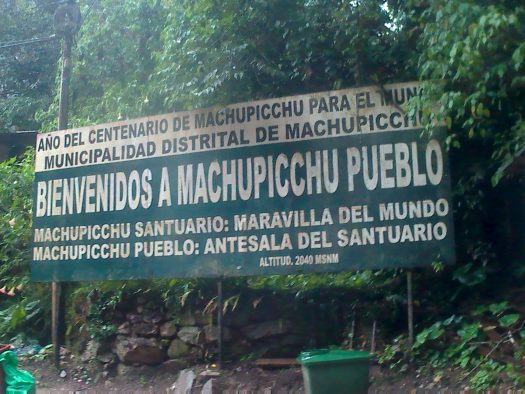K in Motion Travel Blog. Adventures In Southern Peru. Aguas Calientes. Welcome to Machu Picchu Pueblo Sign, in the Andes, Peru
