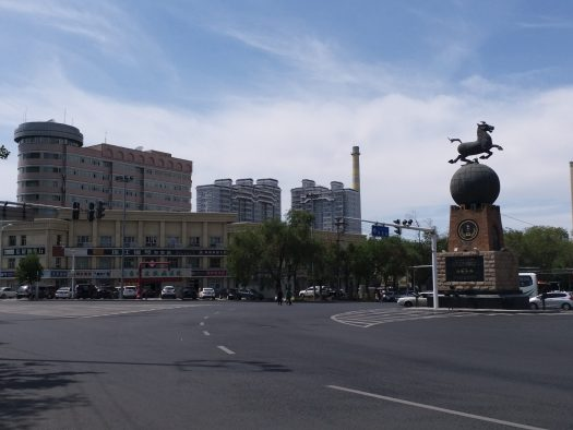 K in Motion Travel Blog. Journey to Kazakhstan Via Western China. Urumqi Horse Statue at intersection