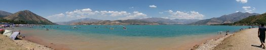 K in Motion Travel Blog. Underrated Uzbekistan. Super Crowded Beach at Lake Charvaq Viewed From Ground Level