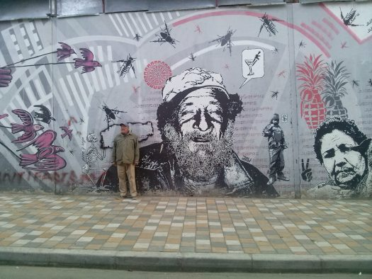 K in Motion Travel Blog. Contemporary Colombia and its Colourful Cities. Old Man and Mural