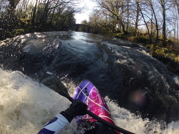 Squirt boat Surfing the River Dart