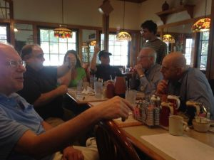 Members of the club gathering for breakfast at one of the local restaurants.