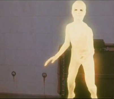 """Image of an alien from the movie, """"Cocoon,"""" which looks like a blank, feature-less human figure"""