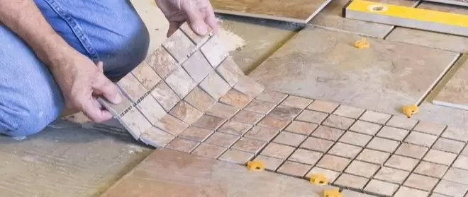 you install ceramic tile under cabinets