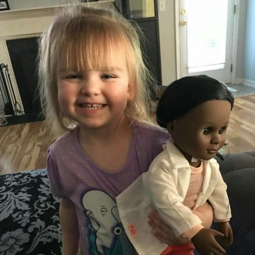 cute kid and doll