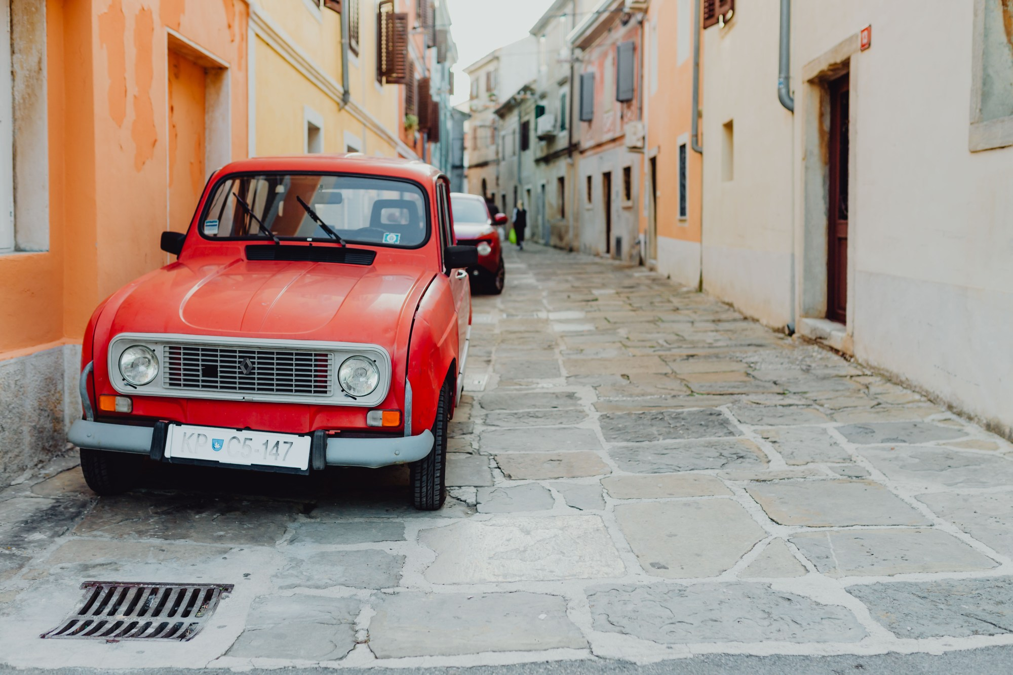 hight resolution of an old red renault 4 car parked on the street in izola slovenia