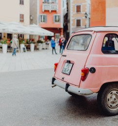 pink renault 4 on the street in the city of rovinj croatia [ 5472 x 3648 Pixel ]