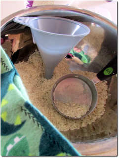 Filling the Bean Bag Hand-Warmer Inserts With Rice and a Funnel
