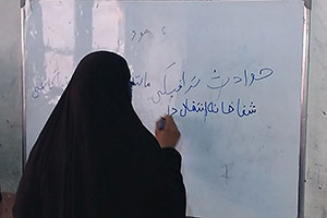 Female student studying at Roqia Center adult literacy class.