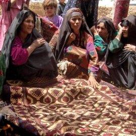 Afghan women selling rugs.