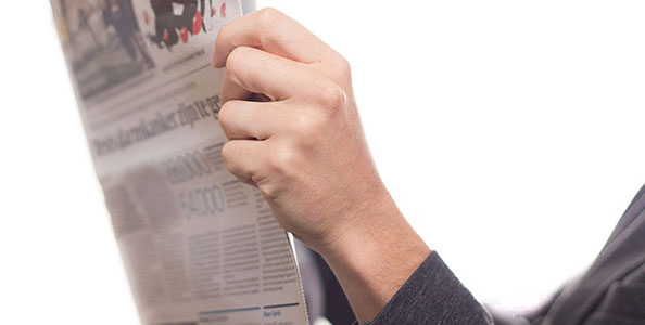 Woman holding newspaper.