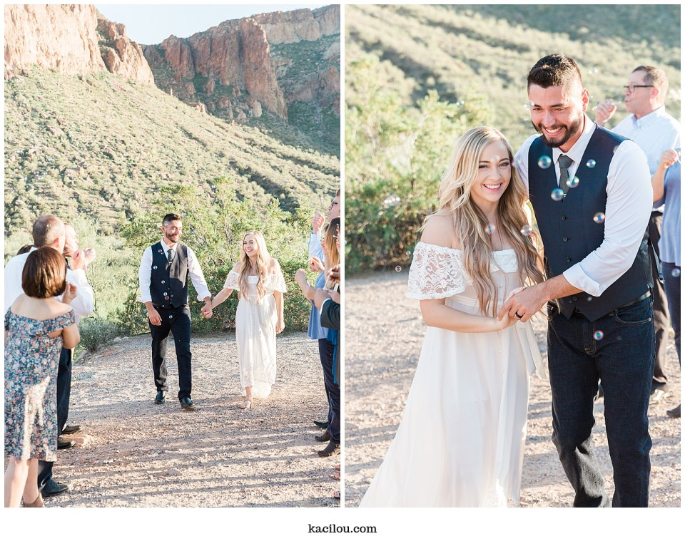 Salt river elopement photo of bride and groom celebrating with bubbles