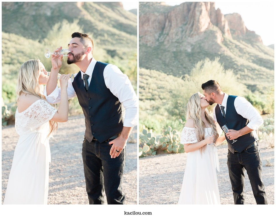 Salt river elopement photo of bride and groom celebrating with champagne