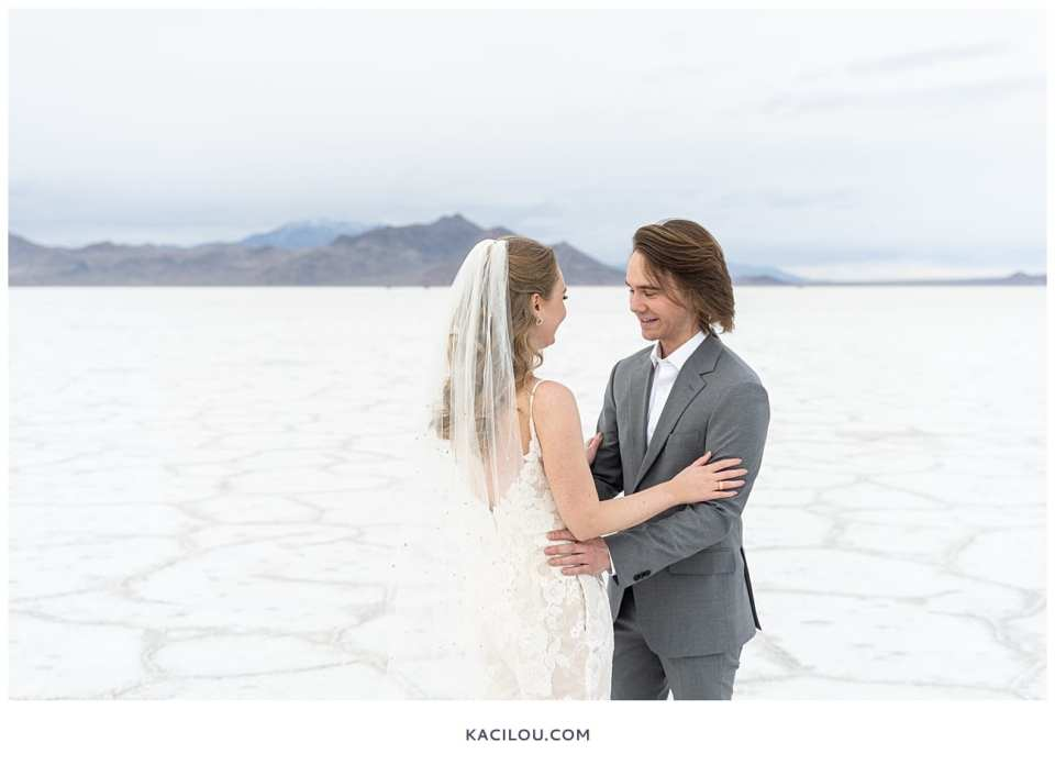 groom seeing bride for first time at salt flats