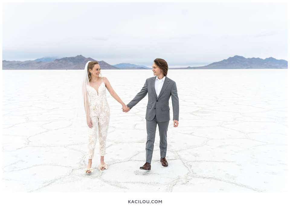 bride and groom walking with each other at salt flats