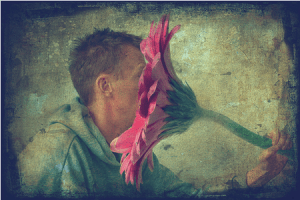 Man smelling flower