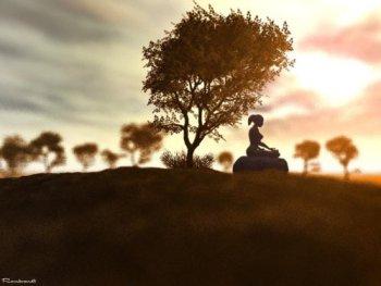 woman meditating under tree