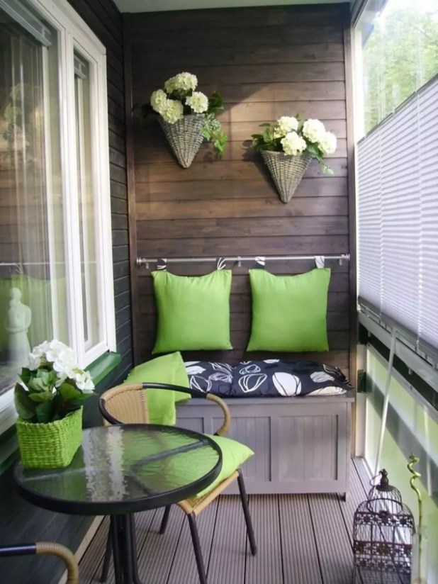small-balcony-design-ideas-with-wooden-walls-and-creame-rugs-also-wall-mounted-desk-wirh-green-cushion-and-floral-seats-also-rattan-chair-and-round-glass-coffee-table-1024x1365