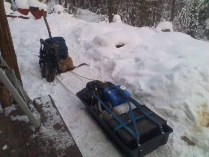 """The ski """"pulk"""" Loaded down with a months worth of supplies."""