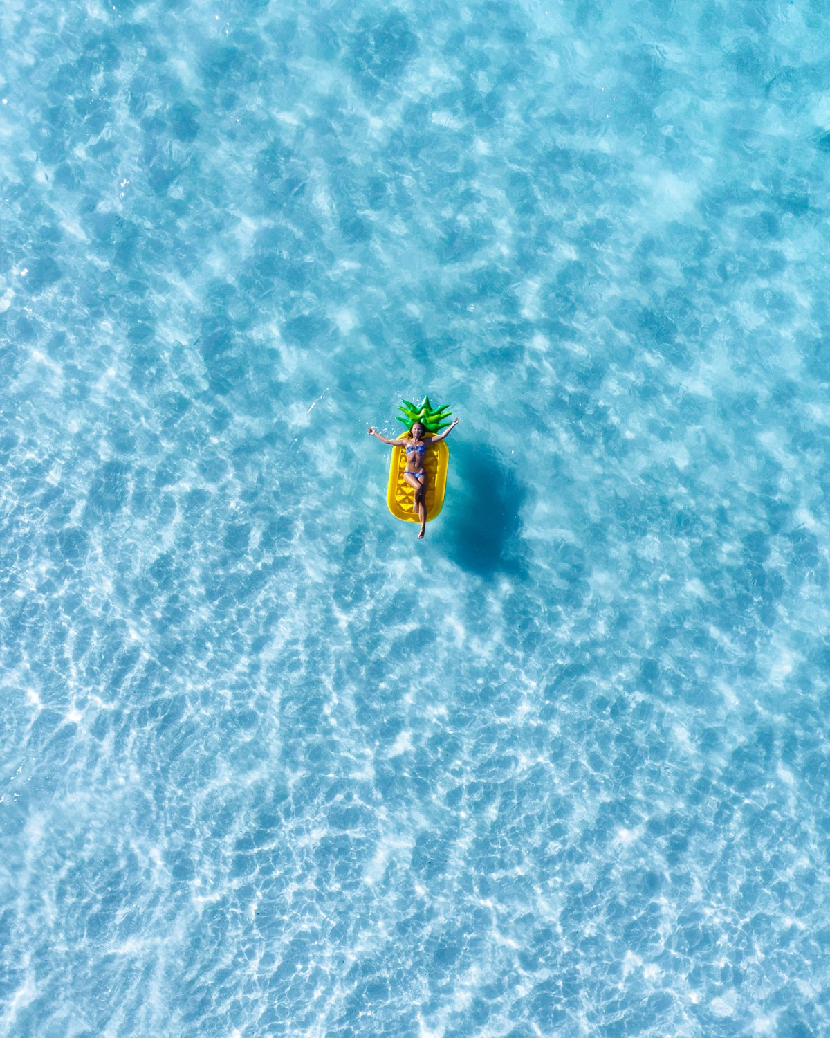 Girl Floating on Pineapple Inflatable