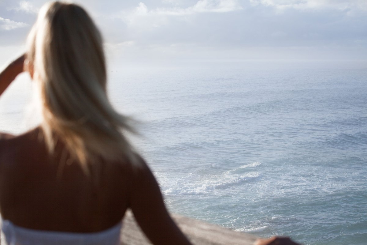 Girl Looking Out To The Ocean