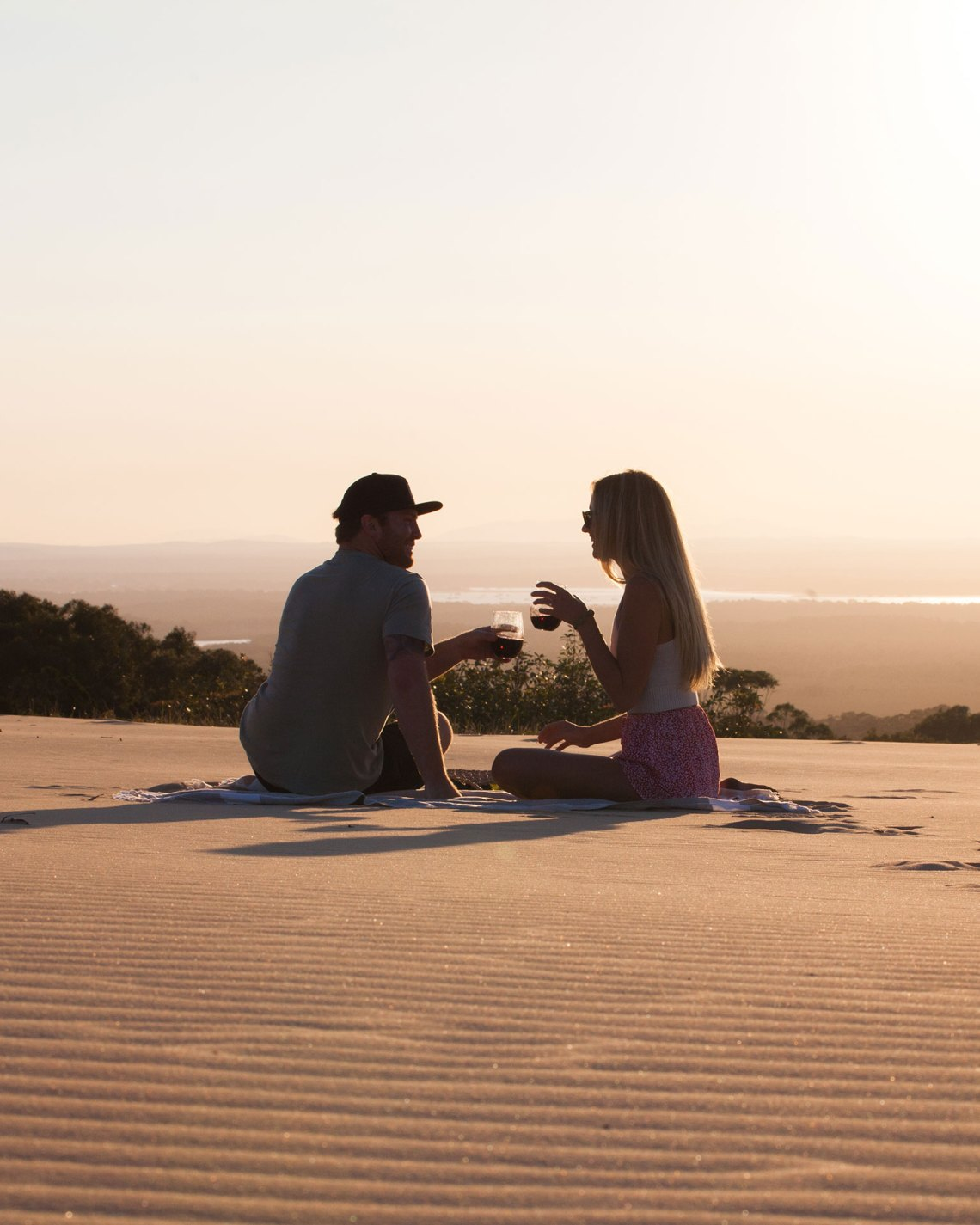 Kaede and James Sitting on Sand Dune