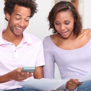 Couple working out finances - Earnings and Personal Planning