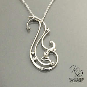 Cresting Waves forged silver pendant by Kaelin Design