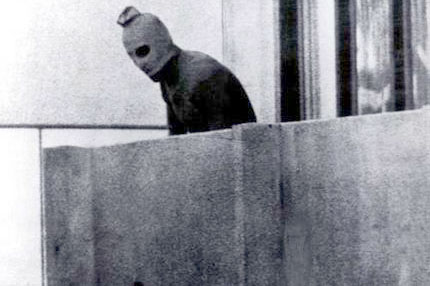 A masked Black September terrorist during the 1972 Munich Olympics attack