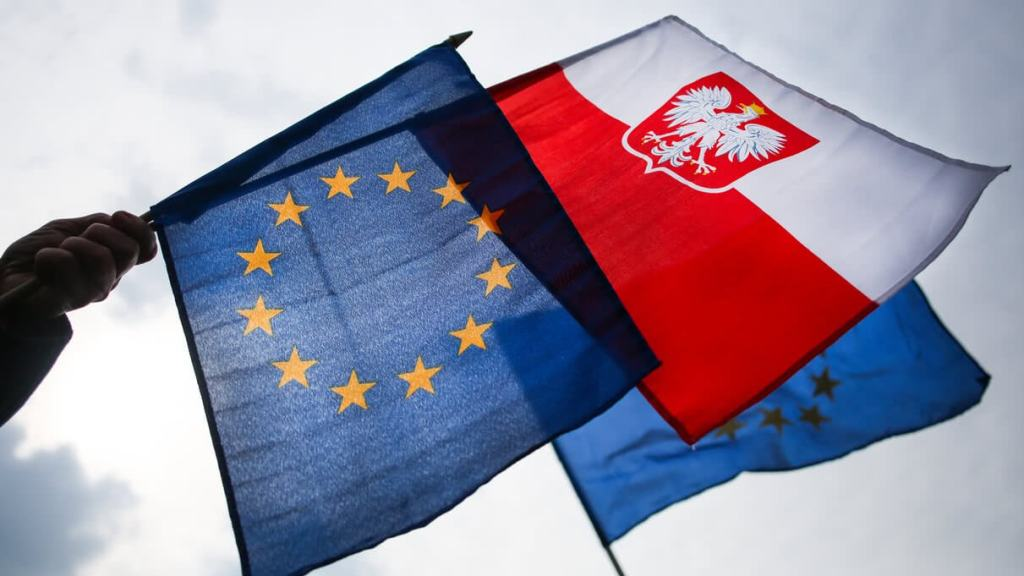 Polish and EU flags waving in the air