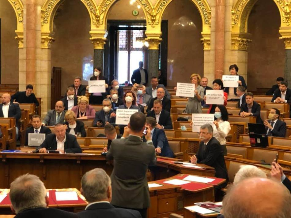 Female Hungarian lawmakers hold protest banners in Parliament after the vote rejected the Istanbul Convention