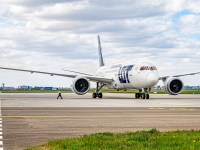 A LOT Polish Airlines plane on the Warsaw Airport runway