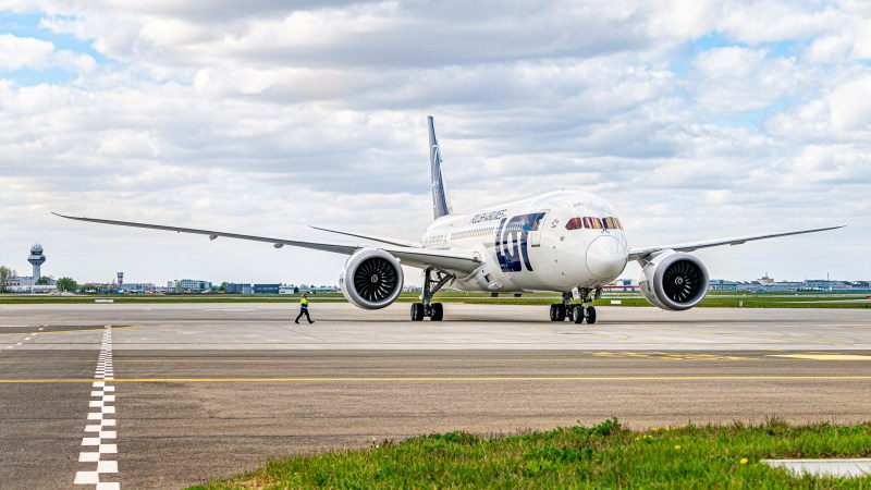 A LOT Polish Airlines plane on the runway of Warsaw Chopin Airport