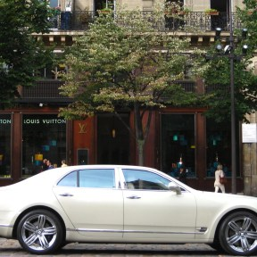 Right opposite the church, LV & a Bentley. I don't think St. Antoine would approve.