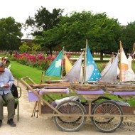 A chap renting large, toy sailboats to use in one of the fountains.