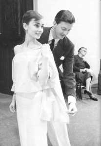 Audrey Hepburn being fitted by Hubert de Givenchy. Source: style.rs
