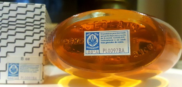 Letters carved into base of a 1976 vintage Shalimar EDT bottle. Photo: my own.