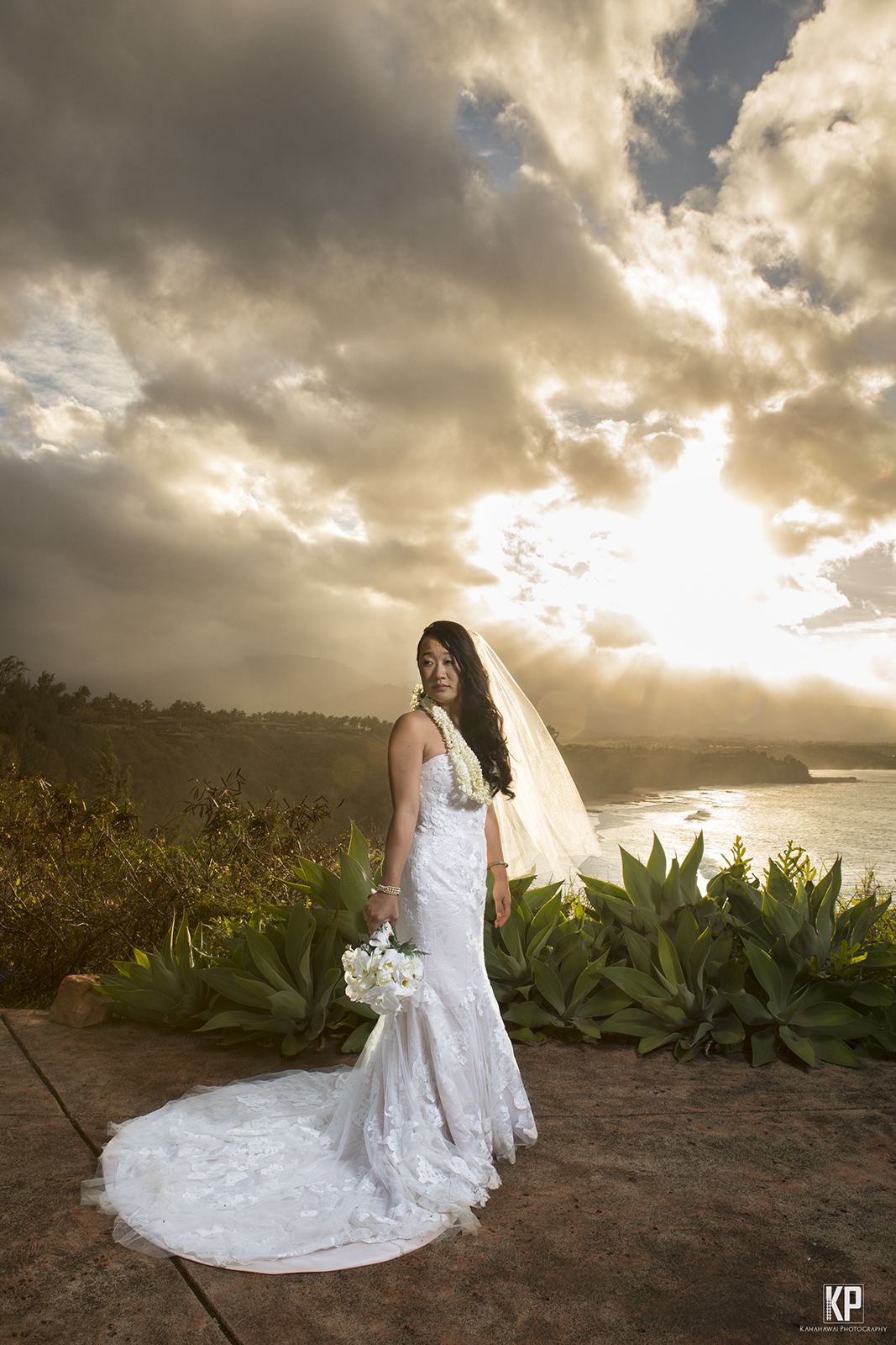 Bride overlooking incredible Kauai Sunset