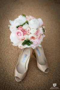 Setting the bouquet and shoes up in the clean patch of sand isolates the lines and colors perfectly