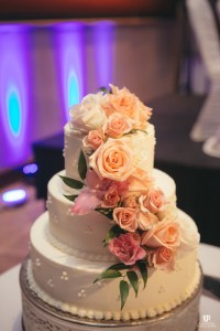 Kauai weddings don't hold back when it comes to decor! This wedding cake literally takes the cake! Incredible imagery captured by Kahahawai Photography
