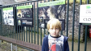 Happy about waiting in the rain to go on the underground boat at Speedwell Cavern.
