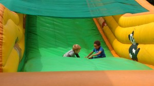 Kai & Raph on one of the inflatable slides at Hillsborough Park Fair.