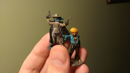 Two painted tabletop miniatures of Horace 'Action' Johnson and The Black Mist