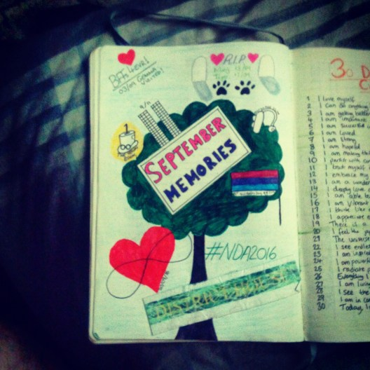 Page coloured green with a tree in the centre, with other doodles around it. Text in middle reads 'September Memories'