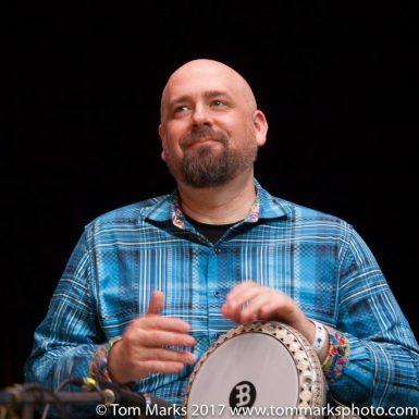 Kai Strandskov in blue shirt playing doumbek