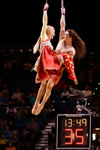 A couple from Cirque du Soleil perform during halftime of the Pac-12 Tournament Championship at the MGM Grand Garden Arena in Las Vegas on Saturday, March 16, 2013. (Kai Casey/CU Independent)