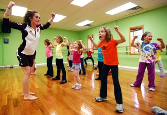 "Freshman Samantha Tortomasi plays ""Miss Sam Says"" with girls at a dance workshop at the Off Broadway Dance Studio in Mount Pleasant Saturday morning. The CMU Chippettes taught the workshop for 6 to 11 year olds."