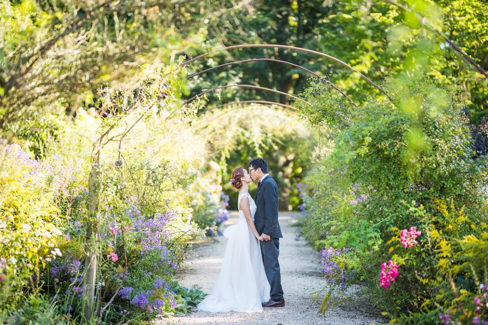 under a metal arbor Kaitlyn Ferris photography garden wedding